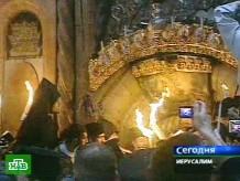 Благодатный огонь сошел на верующих.НТВ.Ru: новости, видео, программы телеканала НТВ