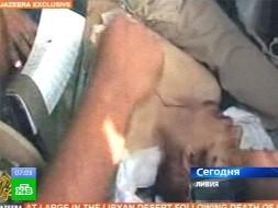Тело Муаммара показали журналистам