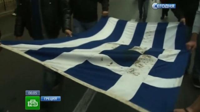 Полиция с боем разогнала митингующих у посольства США в Афинах.Афины, Греция, беспорядки, митинги и протесты.НТВ.Ru: новости, видео, программы телеканала НТВ