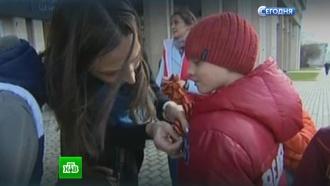 Символ праздника: в Москве раздали более 5 млн георгиевских лент