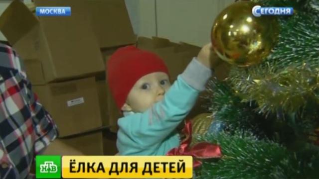 #СмируПоЕлке: онкобольных детей можно поддержать новогодней фотографией.Москва, Новый год, благотворительность, болезни, дети и подростки, онкологические заболевания.НТВ.Ru: новости, видео, программы телеканала НТВ