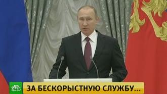 Путин наградил госпремиями священника и Доктора Лизу