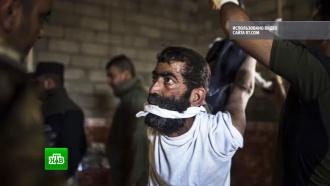 Фотограф запечатлел издевательства иракских военных над жителями Мосула