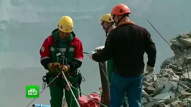 ВЯкутии спасатели стучат по трубам внадежде найти горняков живыми.Якутия, аварии на шахтах, шахты и рудники.НТВ.Ru: новости, видео, программы телеканала НТВ