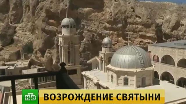Настоятель храма вСирии передал России икону святой Фёклы взнак благодарности.Сирия, войны и вооруженные конфликты, религия, терроризм, христианство.НТВ.Ru: новости, видео, программы телеканала НТВ