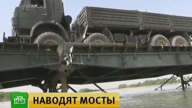 Российские военные под огнем террористов возвели мост через Евфрат.войны и вооруженные конфликты, Минобороны РФ, мосты, Сирия, терроризм.НТВ.Ru: новости, видео, программы телеканала НТВ