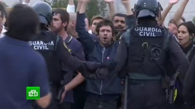 ВКаталонии встычках сполицией пострадали более 330человек.Испания, Каталония, беспорядки, референдумы.НТВ.Ru: новости, видео, программы телеканала НТВ