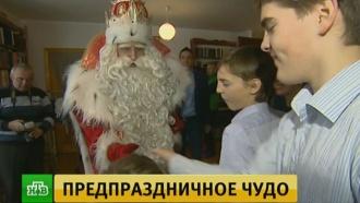 Дед Мороз икоманда НТВ посетили большую семью вНовосибирске