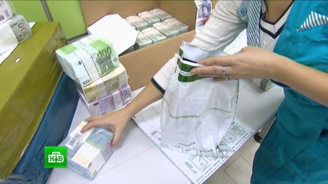 Минфин потратит на февральские закупки валюты рекордные 300 млрд рублей.валюта, золотовалютные резервы, Минфин РФ, нефть, рубль, экономика и бизнес.НТВ.Ru: новости, видео, программы телеканала НТВ