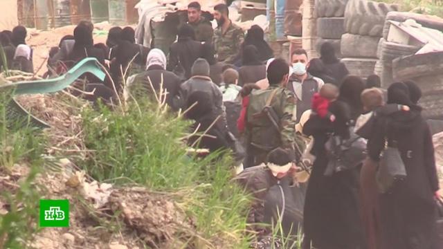 Из Восточной Гуты вышли около тысячи боевиков и членов их семей.Сирия, армия и флот РФ, беженцы, войны и вооруженные конфликты, терроризм.НТВ.Ru: новости, видео, программы телеканала НТВ