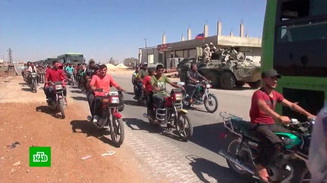 Около 800беженцев ибывших боевиков вернулись вродной поселок вСирии.Сирия, армия и флот РФ, беженцы, войны и вооруженные конфликты.НТВ.Ru: новости, видео, программы телеканала НТВ