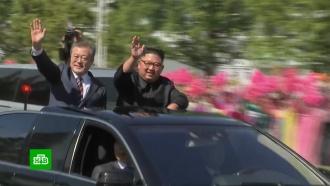 Мун Чжэ Ина вПхеньяне встретили десятки тысяч нарядных северокорейцев сцветами