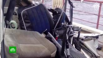 Вупавшем на дно иркутской реки вертолете нашли мертвых людей
