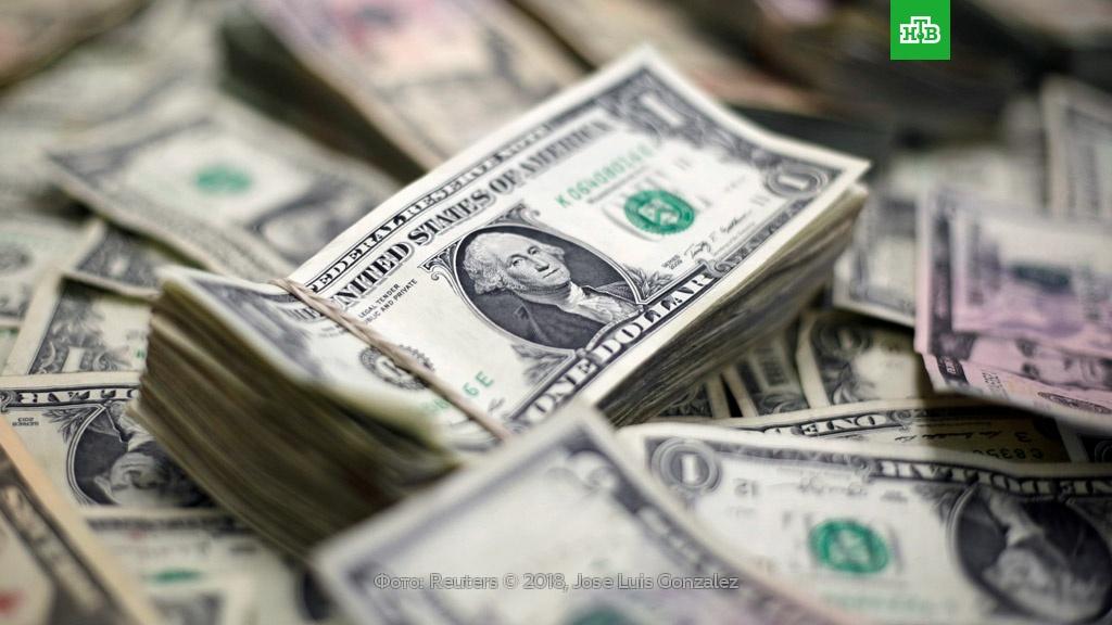 Минфин: доллар не опустится до «справедливых» 50 рублей в 2018 году.валюта, доллар, Минфин РФ, рубль.НТВ.Ru: новости, видео, программы телеканала НТВ
