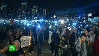 Жители Сиднея протестуют против рекламы скачек на здании оперы