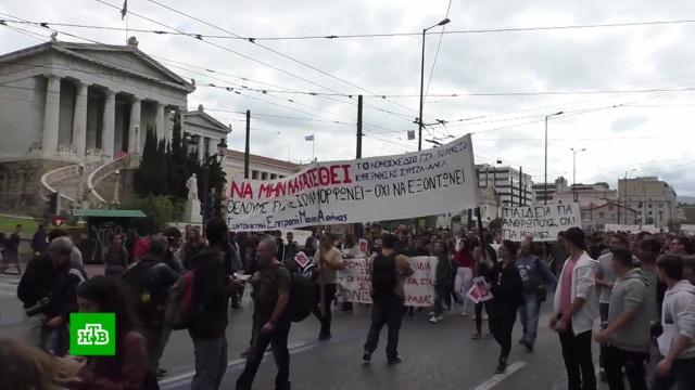 ВАфинах применили слезоточивый газ для разгона демонстрации школьников.Афины, Греция, демонстрации, митинги и протесты.НТВ.Ru: новости, видео, программы телеканала НТВ