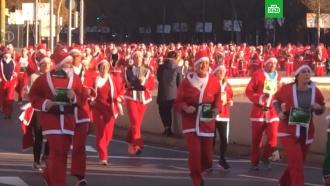 Тысячи <nobr>Санта-Клаусов</nobr> пробежались по Мадриду