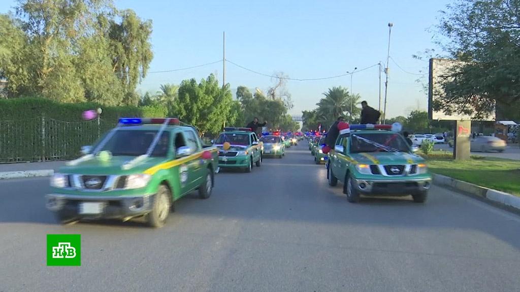 Ирак празднует годовщину победы над ИГ, несмотря на вылазки боевиков.Ирак, Исламское государство, Сирия, терроризм.НТВ.Ru: новости, видео, программы телеканала НТВ