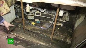 ВЯкутске чиновники не признают аварийным дом сдырами встенах