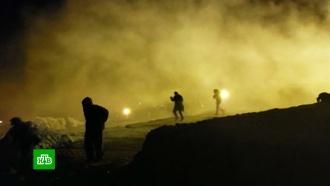 Власти США назвали применение слезоточивого газа против беженцев вынужденным