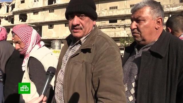Российские военные доставили две тонны хлеба жителям Алеппо.Сирия, армия и флот РФ, войны и вооруженные конфликты, гуманитарная помощь.НТВ.Ru: новости, видео, программы телеканала НТВ