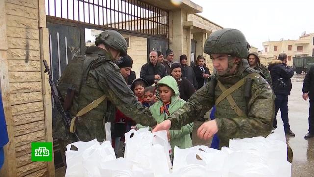 Христиане сирийской Мухрады получили от российских военных 2тонны еды.Сирия, войны и вооруженные конфликты, гуманитарная помощь, продукты.НТВ.Ru: новости, видео, программы телеканала НТВ