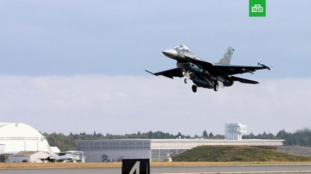 Истребитель-бомбардировщик F-2 потерпел крушение в Японии.Истребитель-бомбардировщик F-2 пропал радаров вскоре после вылета с базы Цуики в префектуре Фукуока. Самолет, совершавший учебный полет, предположительно рухнул в Японское море.Япония, авиационные катастрофы и происшествия, самолеты.НТВ.Ru: новости, видео, программы телеканала НТВ
