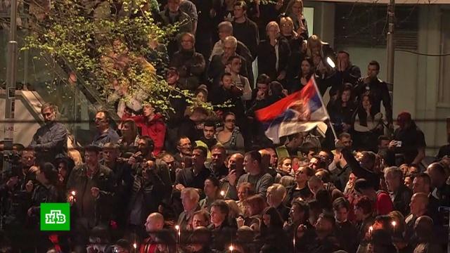ВБелграде вгодовщину бомбардировок НАТО устроили антиправительственную акцию.Косово, НАТО, Сербия, история, памятные даты.НТВ.Ru: новости, видео, программы телеканала НТВ