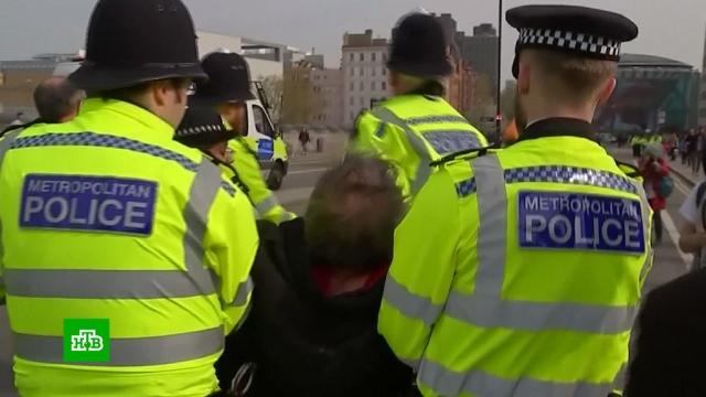 Полиция Лондона задержала 500участников экологических протестов.Лондон, задержание, митинги и протесты.НТВ.Ru: новости, видео, программы телеканала НТВ