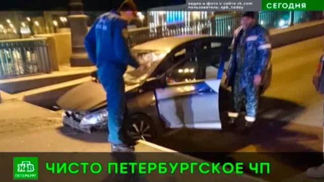 Итальянец на машине попытался перепрыгнуть через разводной мост вПетербурге.ДТП, Санкт-Петербург.НТВ.Ru: новости, видео, программы телеканала НТВ