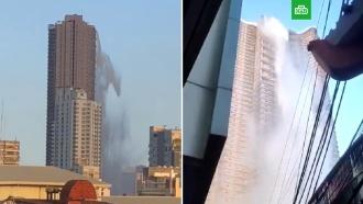 Бассейн пролился скрыши небоскреба во время землетрясения