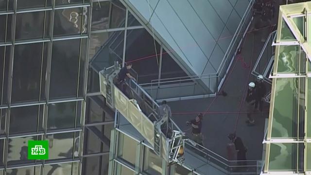 Пожарные в США спасли застрявших на небоскребе мойщиков окон.США, небоскребы.НТВ.Ru: новости, видео, программы телеканала НТВ