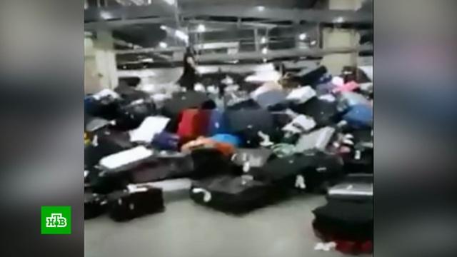 Нехватка грузчиков привела кзадержкам свыдачей багажа вШереметьево.Аэрофлот, авиакомпании, аэропорт Шереметьево, аэропорты.НТВ.Ru: новости, видео, программы телеканала НТВ