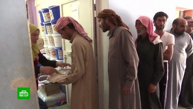 Сирийские власти оказывают помощь беженцам из лагеря «Рукбан».Сирия, беженцы, войны и вооруженные конфликты.НТВ.Ru: новости, видео, программы телеканала НТВ