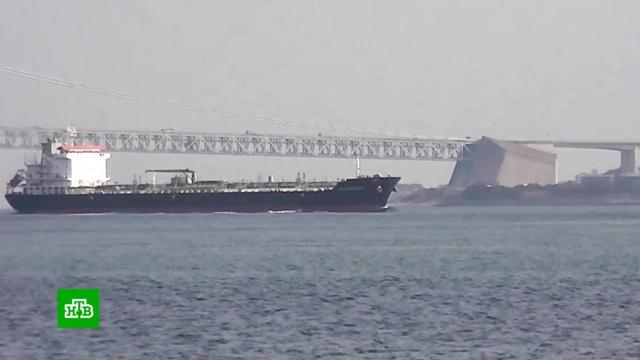 В Оманском заливе ищут организаторов атаки на танкеры.Иран, корабли и суда, пожары.НТВ.Ru: новости, видео, программы телеканала НТВ