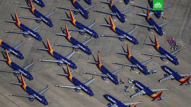 В США нашли кладбище самолетов Boeing 737 Max.В Южной Калифорнии нашли «кладбище» самолетов Boeing 737 Max, на которых запрещено летать. Как оказалось, проблемные самолеты «припаркованы» на стоянке логистического аэропорта в городе Викторвилле.США, самолеты.НТВ.Ru: новости, видео, программы телеканала НТВ