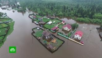 В Иркутской области люди строят дамбы в ожидании большой воды