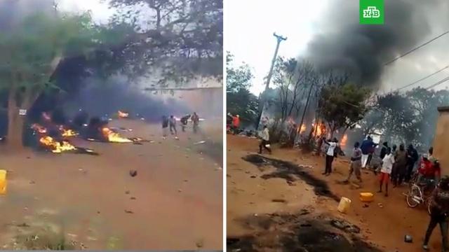 Не менее 60человек сгорели, собирая разлившееся топливо.Африка, бензин, взрывы, смерть.НТВ.Ru: новости, видео, программы телеканала НТВ