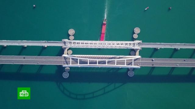 Последние штрихи: на Крымском мосту готовятся кзапуску железнодорожных составов.Крым, железные дороги, мосты, строительство.НТВ.Ru: новости, видео, программы телеканала НТВ