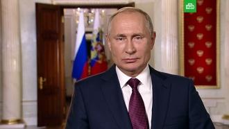 Путин пообещал активно внедрять в России электронные визы