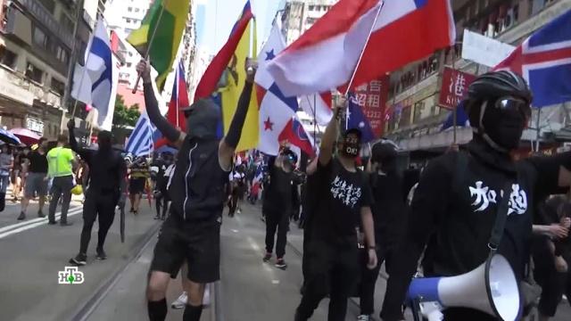 Запрет на ношение масок вГонконге спровоцировал новую волну беспорядков.Гонконг, Китай, беспорядки, митинги и протесты.НТВ.Ru: новости, видео, программы телеканала НТВ