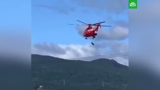 Падение пожилой японки со спасательного вертолета сняли на видео