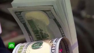 Bloomberg: Россия потеряла за год $8млрд <nobr>из-за</nobr> дедолларизации