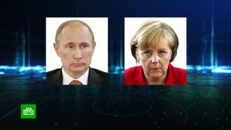Путин иМеркель провели телефонные переговоры