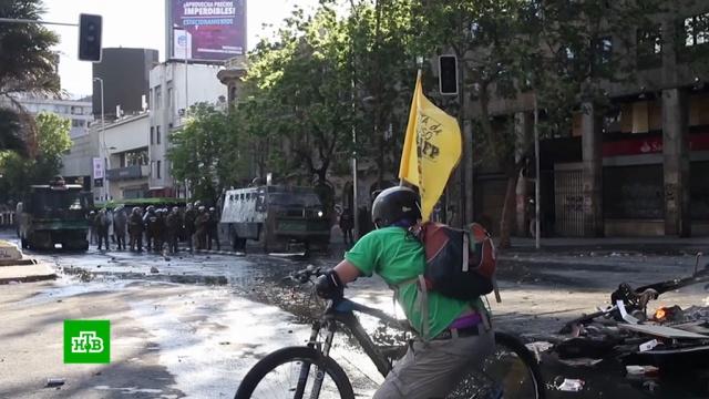 Президент Чили сравнил беспорядки встране свойной.Чили, общественный транспорт, пожары, полиция.НТВ.Ru: новости, видео, программы телеканала НТВ