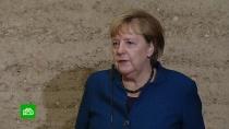 Меркель уфрагмента Берлинской стены призвала защищать свободу идемократию