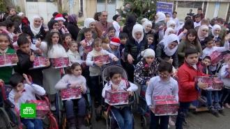 Российские военные провели вСирии предновогоднюю благотворительную акцию