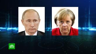 Путин обсудил с Меркель подготовку к берлинской конференции по Ливии