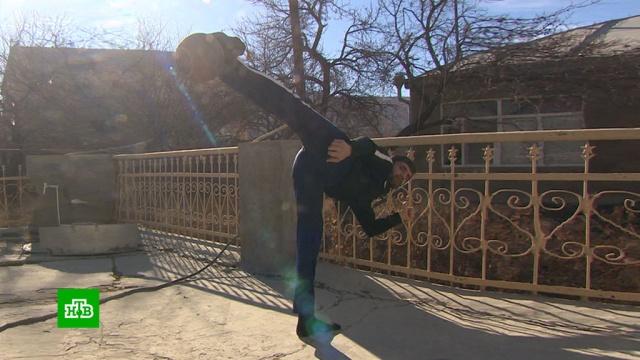Дагестанец удержал гирю без помощи рук иустановил мировой рекорд.Дагестан, рекорды, спорт.НТВ.Ru: новости, видео, программы телеканала НТВ