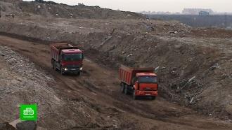 Бывший мусорный полигон на севере Петербурга закрывают земляным панцирем